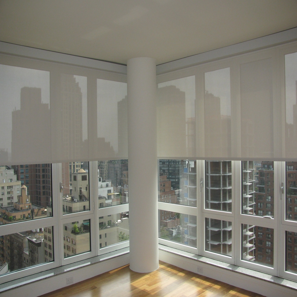 motorized-Sunscreen Roller Shades in Downtown Condo